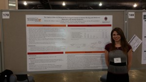 Rebecca Mahan in front of poster at SRCD